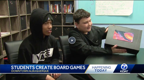 Students showing their board games they created on KOAT Action 7 News